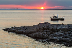 Fishing boat at sunset. Appledore Island, Maine.
