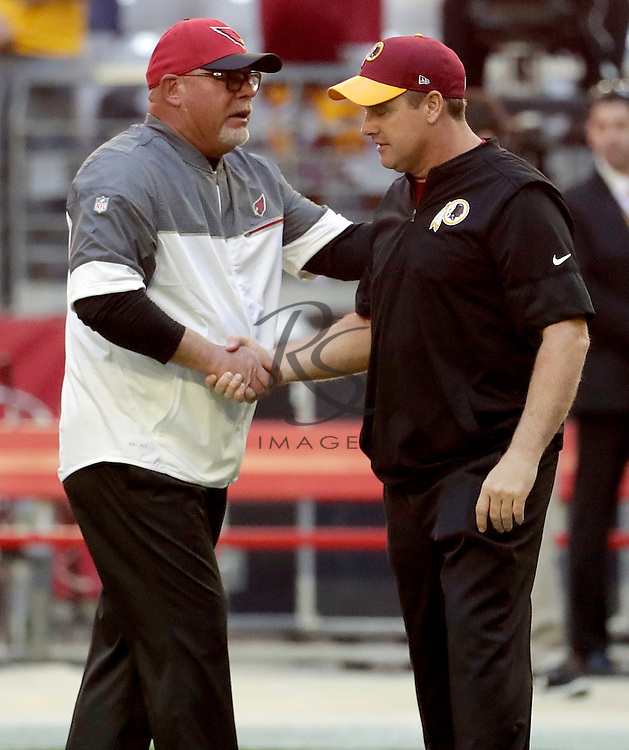 Arizona Cardinals head coach Bruce Arians greets Washington Redskins head coach Jay Gruden prior to an NFL football game, Sunday, Dec. 4, 2016, in Glendale, Ariz. (AP Photo/Rick Scuteri)