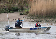 23 March 2019. Boat Race Fixture.  OUWBC vs Molesey BC.<br /> <br /> Pictured:- OUWBC Head Coach Andy Nelder.<br /> <br /> As preparation for the The Boat Races, Oxford and Cambridge clubs participate in a number of Fixtures against other clubs, rowing the same Tideway course as used for the Boat Race.<br /> <br /> OUWBC Crew List (Yellow hulled boat):-<br /> Stroke: Amelia Standing, 7. Tina Christmann, 6. Beth Bridgman, 5. Liv Pryer, 4. Lizzie Polgreen, 3. Renée Koolschijn, 2. Anna Murgatroyd, Bow. Issy Dodds, Cox. Eleanor Shearer,