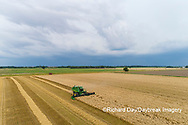 63801-14318 Aerial view of combine harvesting wheat ahead of a thunderstorm Marion Co. IL