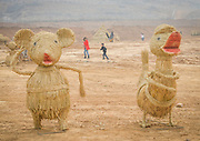 LUOYANG, CHINA - MARCH 16: (CHINA OUT) <br /> <br /> A straw duck and straw panda are seen at a construction site on March 16, 2016 in Luoyang, Henan Province of China. Various straw dolls like dinosaurs, ducks, Minions, elephants, pandas and small trains as well we others are made at a construction site which attracted citizens and visitors.<br /> ©Exclusivepix Media