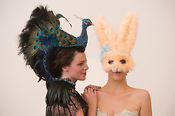The Animal Ball..This years Animal Ball which brings the glamour and splendour of a masked soiree to the heart of London will benefit the charity Elephant Family with masks created by the likes of Christian Lacroix, Mario Testino and Swarovski. Pic Shows Natalie Ellner wearing her creation 'Lady Peacock' and Lucy Franks wearing Cecilia Lundquist for Coco De Mer. The masks will be on show at Sotheby's until May 15th, London, UK, May 10, 2013. Photo by:  i-Images