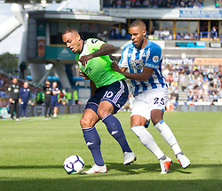 Kenneth Zohore of Cardiff City (L) and Mathias Zanka Jorgensen of Huddersfield Town in action - Mandatory by-line: Jack Phillips/JMP - 25/08/2018 - FOOTBALL - The John Smith's Stadium - Huddersfield, England - Huddersfield Town v Cardiff City - English Premier League