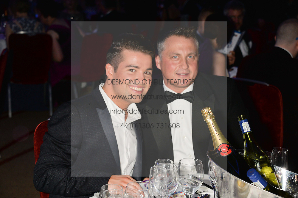 Left to right, JOE McELDERRY and DARREN GOUGH at the Soldiering On Awards held at the Park Plaza Hotel, Westminster Bridge, London on 5th April 2014.