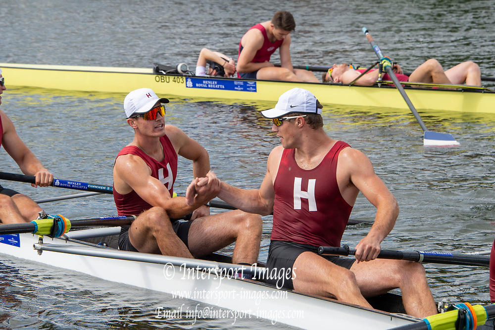 Henley on Thames, England, United Kingdom, 6th July 2019, left, Samual  MONKLEY, grasp's Ethan SEDER hand after crossing the finishing line,  Henley Royal Regatta, a heat of the Prince Albert Challenge Cup, Harvard University take the win against Oxford Brooks University  from the base, of the Press Box,  [© Peter SPURRIER/Intersport Image]<br /> <br /> 10:37:30 1919 - 2019, Royal Henley Peace Regatta Centenary,