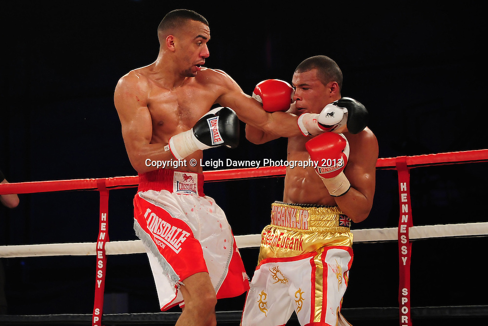 Tyan Booth trades blows with Chris Eubank Jnr during their Middleweight contest at Glow, Bluewater, Dartford, Kent, UK on 8th June 2013. Promoter: Hennessy Sports. Mandatory Credit: © Leigh Dawney
