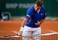 Stanislas Wawrinka of Switzerland hits in the net while men's singles while Day Third during The French Open 2013 at Roland Garros Tennis Club in Paris, France...France, Paris, May 28, 2013..Picture also available in RAW (NEF) or TIFF format on special request...For editorial use only. Any commercial or promotional use requires permission...Mandatory credit:.Photo by © Adam Nurkiewicz / Mediasport