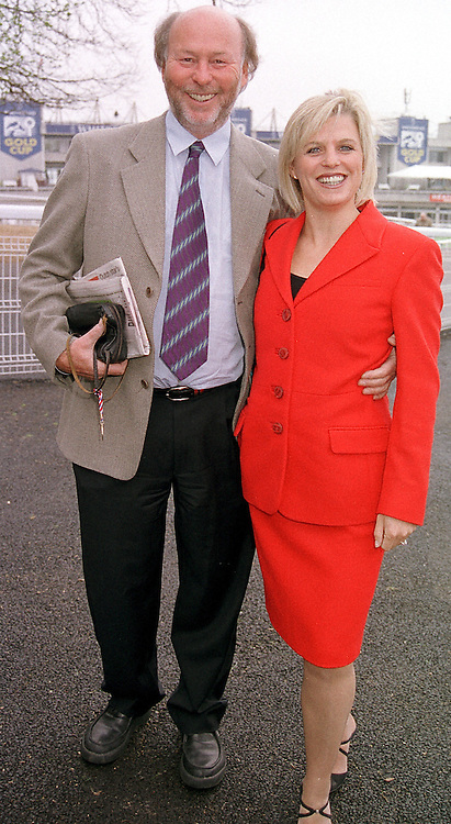 MR CHRIS WRIGHT chairman of QPR FC and MRS JANICE STINNES, at a race meeting in Surrey on 28th April 2000.ODE 19