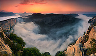 The canyon of the Verdon river is nothing but a must-visit place for anyone living in EU and for anyone planning to visit France from abroad. It's 60 kms long and 700-800 meters deep, with huge vertical sandstone and limestone walls and fantastic spots at every corner...I took this picture at dawn at the end of August, from atop the highest cliff of the canyon, at about 1300 meters of altitude. .I was very lucky indeed with the light and the low clouds that morning. It had rained the afternoon and the night before, so I was hoping for some nice combination of light and clouds, but honestly what I found when I reached the location at 6AM was far beyond my sweetest anticipation. I stayed up there in awe for about 1,5 hour, attending one of the best nature show my eyes had ever witnessed. ..This is a stitch of 7 vertical takes.