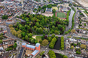 Nederland, Noord-Brabant, Breda, 09-05-2013; centrum van Breda, stadspark Valkenberg gezien naar Grote of Onze-Lieve-Vrouwekerk. Rechts het Kasteel van Breda en de KMA (Koninklijke Militaire Academie). <br /> Center of Breda, public park and the Royal Military Academy next to the rugby fields. <br /> luchtfoto (toeslag op standard tarieven);<br /> aerial photo (additional fee required);<br /> copyright foto/photo Siebe Swart.