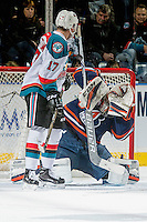 KELOWNA, CANADA - DECEMBER 27: Dylan Ferguson #31 of the Kamloops Blazers blocks a shot and  makes a save as Rodney Southam #17 of the Kelowna Rockets watches for the rebound on December 27, 2016 at Prospera Place in Kelowna, British Columbia, Canada.  (Photo by Marissa Baecker/Shoot the Breeze)  *** Local Caption ***