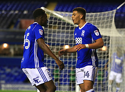 Birmingham City's Che Adams (right) celebrates scoring his side's fifth goal of the game against Crawley Town with Wes Harding