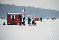 Where neighbors become friends as folks converge onto Meredith Bay Village during the annual Great Meredith Rotary Ice Fishing Derby.  (Karen Bobotas/for the Laconia Daily Sun)