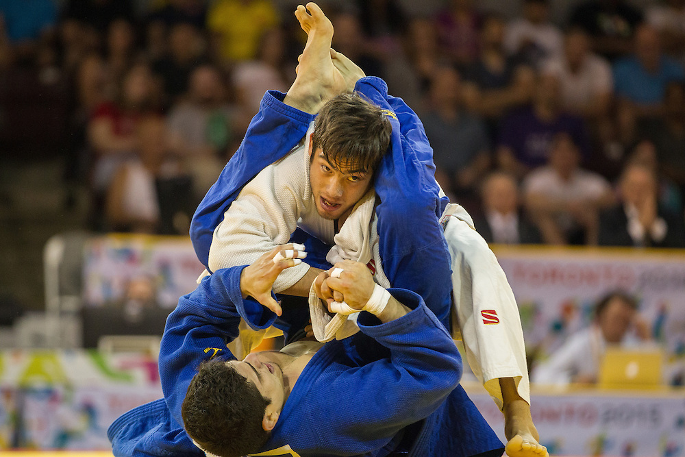David Tavera (top) of Mexico and  Fernando Ibanez of Ecuador struggle for position during their 1/8 final contest in the 73kg class at the 2015 Pan American Games in Toronto, Canada, July 12,  2015.  AFP PHOTO/GEOFF ROBINS
