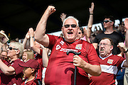 Northampton town celebrate as the team take a 0-1 lead during the Sky Bet League 2 match between Portsmouth and Northampton Town at Fratton Park, Portsmouth, England on 7 May 2016. Photo by Adam Rivers.