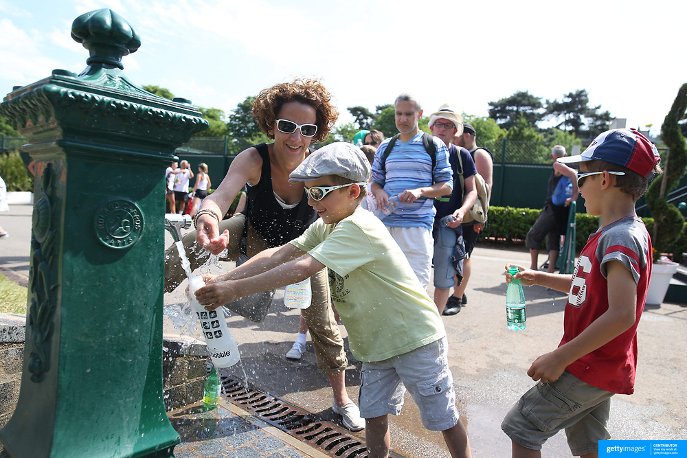 2017 French Open Tennis Tournament - Children's Day. Patrons fill their water bottles on a hot day at the 2017 French Open Tennis Tournament at Roland Garros on May 27th, 2017 in Paris, France.  (Photo by Tim Clayton/Corbis via Getty Images)