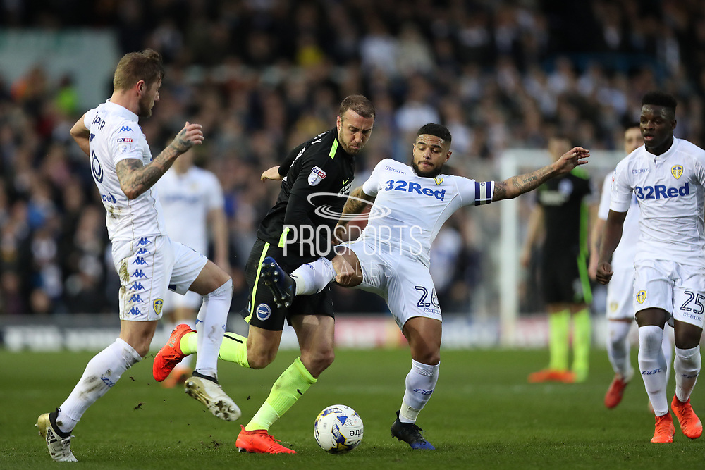 Leeds United midfielder (and former Brighton player) Liam Bridcutt (26) and Leeds United defender Liam Cooper (6) close down Brighton & Hove Albion centre forward Glenn Murray (17) during the EFL Sky Bet Championship match between Leeds United and Brighton and Hove Albion at Elland Road, Leeds, England on 18 March 2017.