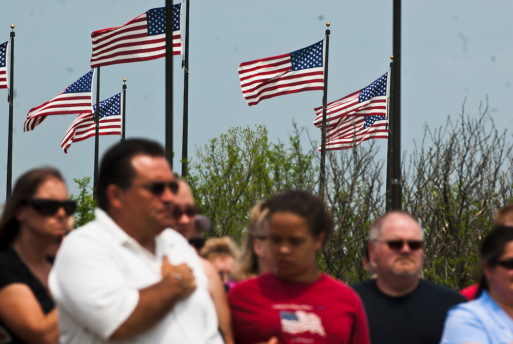 Lathan Goumas | MLive.com..People place their hands over their hears at the pledge of allegiance is recited during the 7th annual Memorial Day ceremony at the Great Lakes National Cemetery in Holly, Mich. on Sunday May 27, 2012.