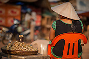 Vietnamese woman selling peanuts at local market in Phu Quoc (Vietnam)
