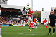 Port Vale&rsquo;s Jordan Slew (l) and Crewe Alexandra&rsquo;s Liam Nolan jump for the ball. Skybet football league one match, Crewe Alexandra v Port Vale at the Alexandra Stadium in Crewe on Saturday 13th Sept 2014.<br /> pic by Chris Stading, Andrew Orchard sports photography.