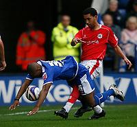 Photo: Steve Bond.<br />Leicester City v Barnsley. Coca Cola Championship. 27/10/2007. Collins John (L) is dumped by Lewin Nyatanga (R)