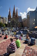 General Event Coverage, March 19, 2014 - Ironman Triathlon : Visitors to Federation Square compete in the instant triathlon. Tougher Than An IRONMAN, Federation Square, Melbourne, Victoria, Australia. Credit: Lucas Wroe