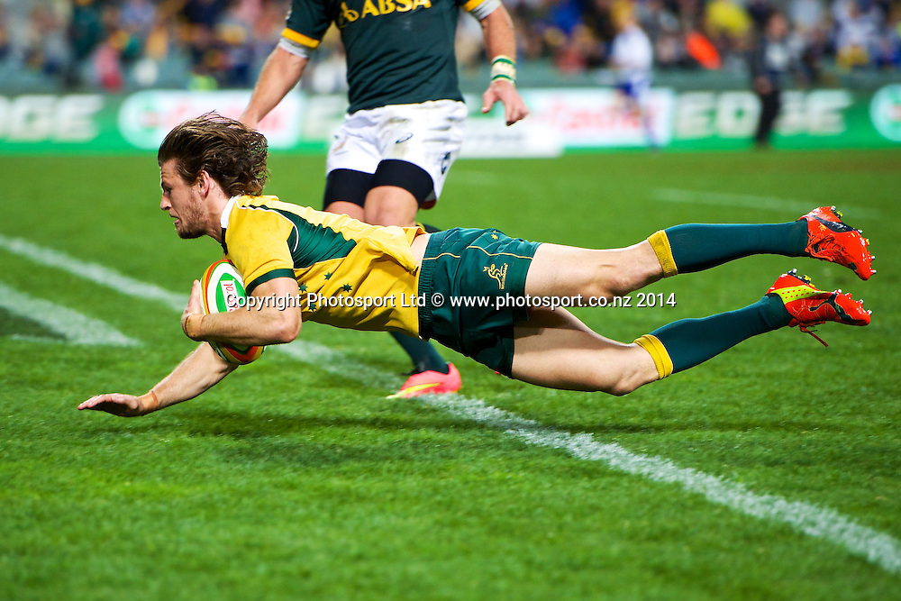 Rob Horne of the Wallabies flies over for a last minute try during the The Rugby Championship match between Australia and South Africa, 6 September 2014. Patersons Stadium, Perth, Western Australia.  Photo: Daniel Carson | photosport.co.nz