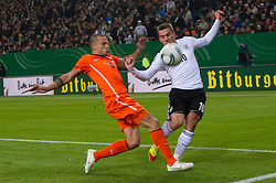15-11-2011 VOETBAL: DUITSLAND - NEDERLAND: HAMBURG<br /> (L-R) John Heitinga,  Lukas Podolski<br /> ***NETHERLANDS ONLY***<br /> ©2011-FRH- NPH/Kokenge