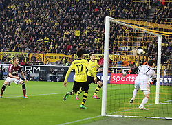 01.03.2014, Signal Iduna Park, Dortmund, GER, 1. FBL, Borussia Dortmund vs 1. FC Nuernberg, 23. Runde, im Bild Mats Hummels (Borussia Dortmund #15) mit dem Fuehrungs Treffer, Tor zum 1:0 gegen Torwart Raphael Schaefer (1 FC Nuernberg #1), Aktion, Action // during the German Bundesliga 23th round match between Borussia Dortmund and 1. FC Nuernberg at the Signal Iduna Park in Dortmund, Germany on 2014/03/01. EXPA Pictures © 2014, PhotoCredit: EXPA/ Eibner-Pressefoto/ Schueler<br /> <br /> *****ATTENTION - OUT of GER*****