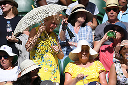 © Licensed to London News Pictures. 02/07/2018. London, UK. Spectators watch centre court tennis in the sweltering heat at the Wimbledon Tennis Championships 2018 <br />  Day 1. Photo credit: Ray Tang/LNP