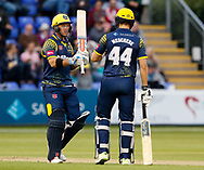 Glamorgan's Colin Ingram celebrates a boundary with team-mate Craig Meschede<br /> <br /> Photographer Simon King/Replay Images<br /> <br /> Vitality Blast T20 - Round 14 - Glamorgan v Surrey - Friday 17th August 2018 - Sophia Gardens - Cardiff<br /> <br /> World Copyright &copy; Replay Images . All rights reserved. info@replayimages.co.uk - http://replayimages.co.uk