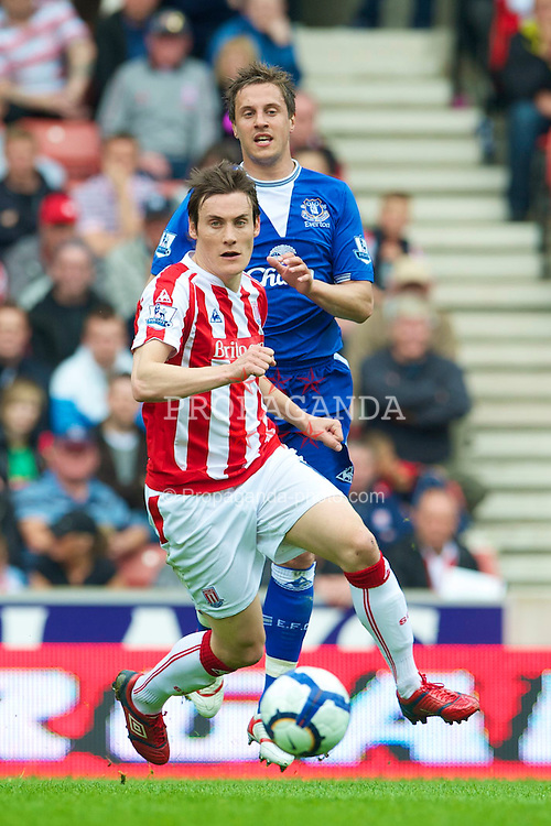 STOKE, ENGLAND - Saturday, May 1, 2010: Everton's Phil Jagielka and Stoke City's Dean Whitehead during the Premiership match at Britannia Stadium. (Photo by David Rawcliffe/Propaganda)