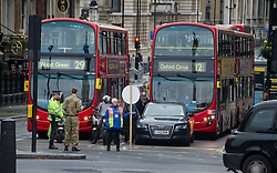 Traffic is stopped in Whitehall for the Two minute silence in Trafalgar Square for Armistice Day-. London, United Kingdom. Monday, 11th November 2013. Picture by i-Images