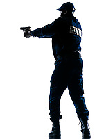 Full length of an Afro American police officer aiming a handgun on white isolated background