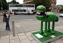 © Licensed to London News Pictures. 06/07/2015. Bristol, UK.  SHAUN THE SHEEP, Rex designed by Beth Waters.  The Shaun in the City trail starts today with 70 5ft tall Shaun the Sheep sculptures originally devised by Aardman Animations with these sculptures decorated by various artists.  The Shaun trail happened in London in the spring, and the Bristol Trail lasts till 31 August.  At the end of September all 120 Shaun sculptures will be viewable together in Covent Garden.  All sculptures will then go to auction on 8th October, with proceeds from the Bristol sculptures benefitting The Grand Appeal which funds pioneering medical equipment, facilities, and comforts for patients at Bristol Children's Hospital. Proceeds from the London sculptures will benefit Wallace & Gromit's Children's Charity supporting children's hospitals and hospices throughout the UK. Photo credit : Simon Chapman/LNP
