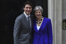 April 18, 2018 - London, England, United Kingdom - British Prime Minister Theresa May greets the Prime Minister of Canada, Justin Trudeau at Number 10 Downing Street, ahead of a bilateral meeting on April 18, 2018 in London, England. Mrs May holds bilateral talks with a number of Commonwealth leaders today as the UK this week hosts heads of state and government from the Commonwealth nations. (Credit Image: © Alberto Pezzali/NurPhoto via ZUMA Press)