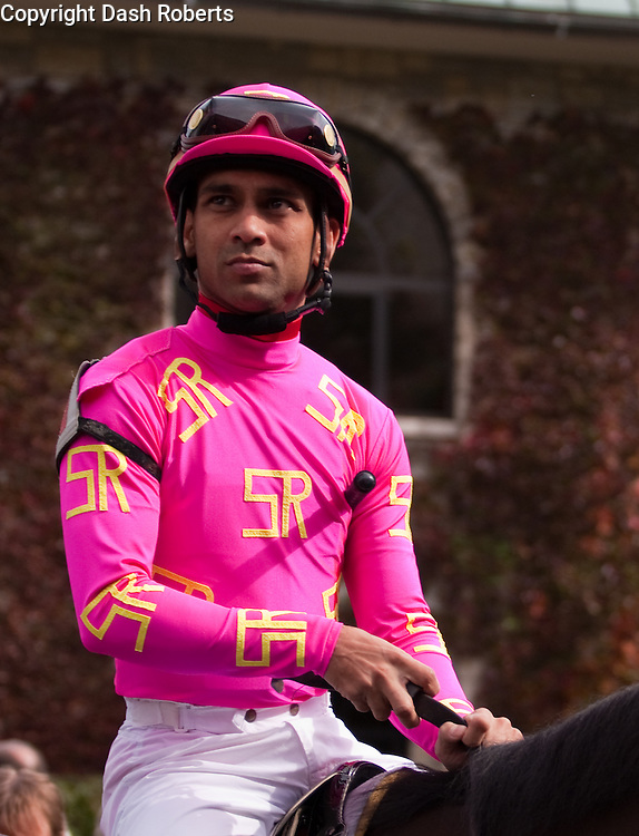 Jockey Shaun Bridgmohan on his mount in the paddock at Keeneland during the 2009 Fall Meet.