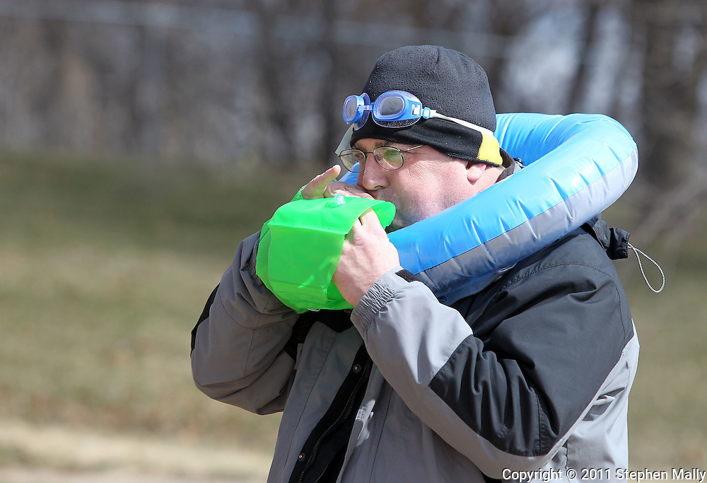 Eugene Pinney, of Cedar Rapids, blows up his arm floaties before the Polar Plunge event at Pleasant Creek State Recreation Area in Palo on Saturday March 26, 2011. 28 team participated in the event which was sponsored by local law enforcement agencies and raised money for Special Olympics Iowa.