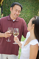 Couple toasting in garden