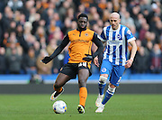 Nouha Dicko and Bruno Saltor, Brighton defender during the Sky Bet Championship match between Brighton and Hove Albion and Wolverhampton Wanderers at the American Express Community Stadium, Brighton and Hove, England on 14 March 2015.