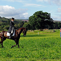 Blair Castle Horse Trials 2012 Photo Essay at Blair Castle, Blair Atholl, Perthshire. A rider practises her dressage test in the warm up area.  Picture Christian Cooksey.