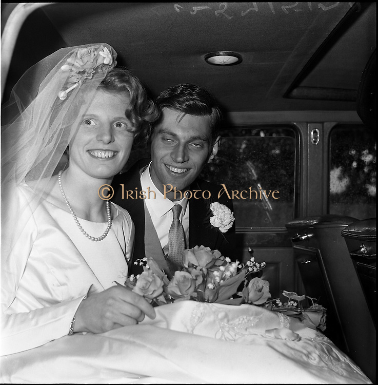 28/06/1963<br /> 06/28/1963<br /> 28 June 1963<br /> Wedding of Mr Michael Slazenger, Powerscourt Demance, Co. Wicklow and Miss Noreen Smith, 17 Leahy terrace, Sandymount, Dublin at the Presbyterian Church, Sandymount. Image shows the couple in the car after the wedding ceremony.