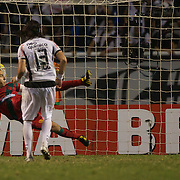 Vasco keeper Fernando is sent the wrong way by Botafogo striker Loco Abreu who scores the equaliser from the penalty spot during the Botafogo V Vasco, Futebol Brasileirao  League match at Estadio Olímpico Joao Havelange, Rio de Janeiro, The classic Rio derby match ended in a 2-2 draw. Rio de Janeiro,  Brazil. 22nd September 2010. Photo Tim Clayton.