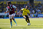 Burton Albion striker Marvin Sordell (9) and Aston Villa defender Neil Taylor (3) during the EFL Sky Bet Championship match between Burton Albion and Aston Villa at the Pirelli Stadium, Burton upon Trent, England on 8 April 2017. Photo by Richard Holmes.