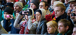 LIVERPOOL, ENGLAND - Saturday, January 30, 2010: Liverpool supporters take photographs during the Premiership match against Bolton Wanderers at Anfield. (Photo by: David Rawcliffe/Propaganda)