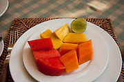 Breakfast fruit of papaya, mango and water melon at the Apsara Guest House in Luang Prabang, Laos.