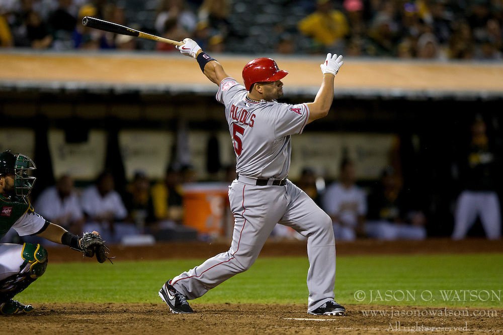 OAKLAND, CA - SEPTEMBER 23:  Albert Pujols #5 of the Los Angeles Angels of Anaheim at bat against the Oakland Athletics during the ninth inning at O.co Coliseum on September 23, 2014 in Oakland, California. The Los Angeles Angels of Anaheim defeated the Oakland Athletics 2-0.  (Photo by Jason O. Watson/Getty Images) *** Local Caption *** Albert Pujols