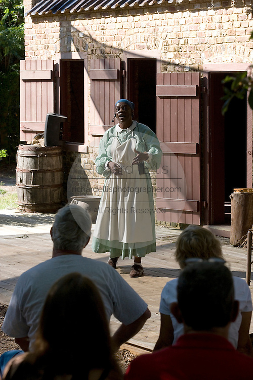 An storyteller dressed as a slave tells stories for tourists at Boone Hall Plantation in Mt. Pleasant, SC, just outside Charleston. Boone Hall is also one of America's oldest working, living plantations. continuously growing and producing crops for over 320 years.