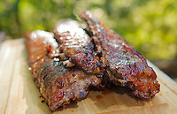 Slow cooked smoked, barbecued pork spare ribs.