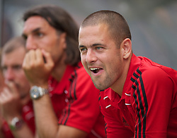 ZUG, SWITZERLAND - Wednesday, July 21, 2010: Liverpool's Joe Cole sits on the bench during the Reds' first preseason match of the 2010/2011 season against Grasshopper Club Zurich at the Herti Stadium. (Pic by David Rawcliffe/Propaganda)